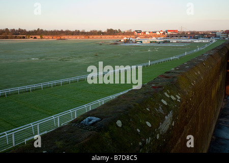 A view of the final stretch toward the final post at Chester Race Course during early morning sunlight - Stock Photo