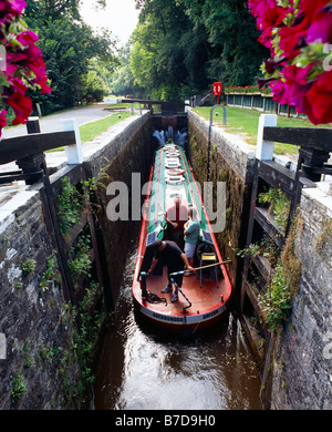 A narrowboat in the Brynich lock on the Monmouthshire and Brecon Canal near Brecon in the Brecon Beacons National - Stock Photo
