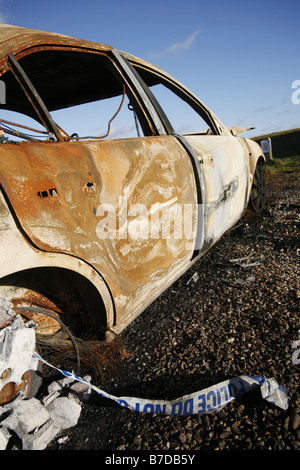 Burnt Out Stolen Car - Stock Photo