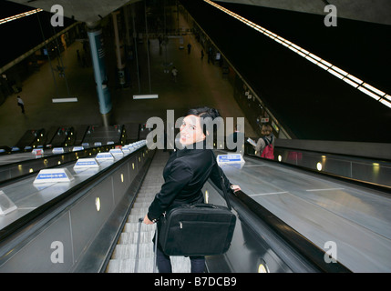Woman on escalator - Stock Photo