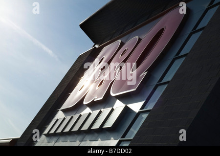A giant B&Q sign on the outside of a mega DIY store in a retail park at Doncaster Yorkshire - Stock Photo