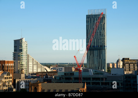 The Great Northern Tower and the Beetham Tower, also known as the Hilton Tower, with a crane in the foreground, - Stock Photo