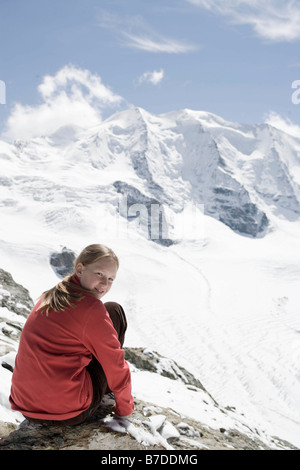 girl walking a path in the mountains - Stock Photo