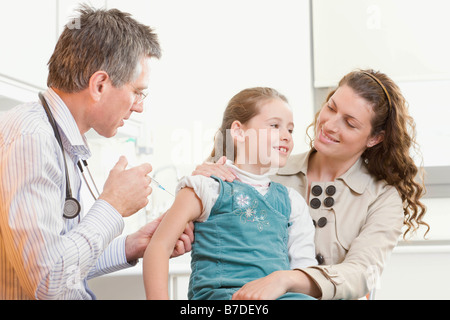 A doctor gives a girl an injection - Stock Photo
