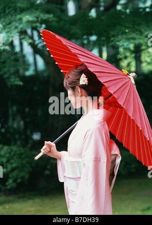 Woman wearing Kimono - Stock Photo