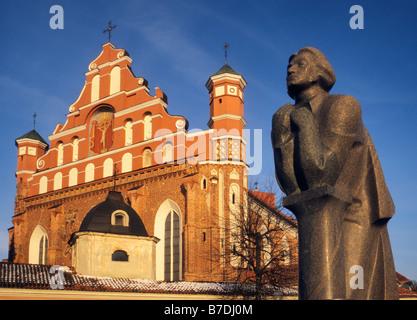 Statue of Polish poet Adam Mickiewicz in front of Bernardine Church in Vilnius Lithuania - Stock Photo