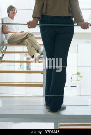 Relaxed couple on stairs - Stock Photo