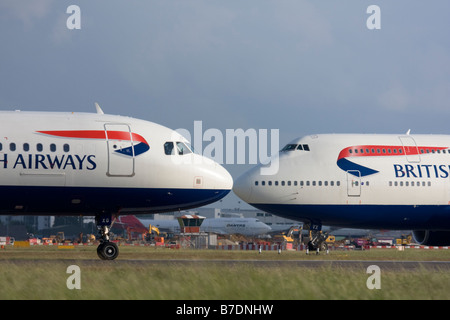 Short-haul and long-haul British Airways planes taxiing for departure at London Heathrow Airport, United Kingdom - Stock Photo