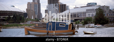 A Live Aboard Boat Squatter anchored in False Creek, Vancouver, BC, British Columbia, Canada - Stock Photo