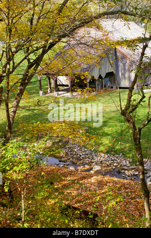 Old Barn and Stream in Autumn - Stock Photo