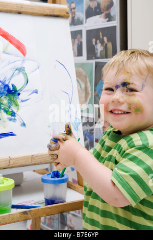 Little boy with paint - Stock Photo