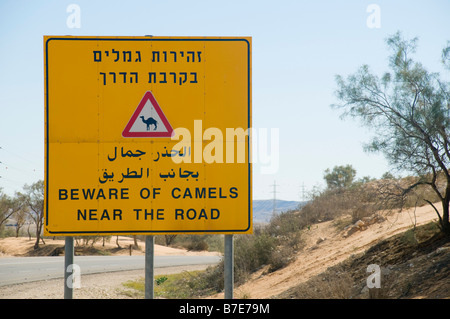 Israel Negev A large yellow warning sign Beware of Camels near the road - Stock Photo