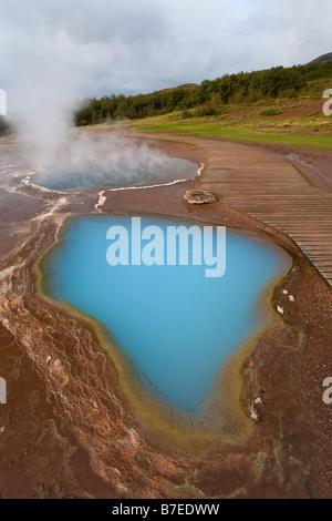 Strokkur (the Churn) which spouts up to 35 meters erupting every 10 minutes, Geysir, Golden Circle, Iceland, Polar - Stock Photo