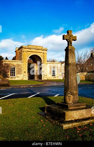 Rudding Gates and Saxon Cross Follifoot Village near Harrogate North Yorkshire - Stock Photo