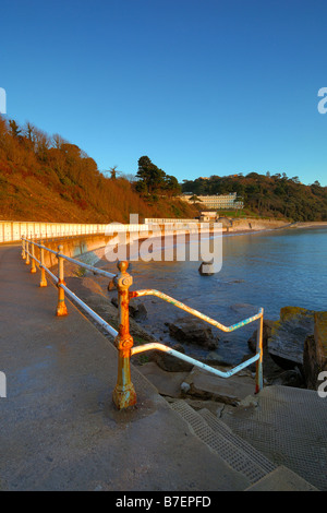 Looking along the promenade of Meadfoot Beach in Torquay in South Devon England at sunrise - Stock Photo