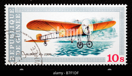 History of aviation, plane Bleriot XI (1909), postage stamp, Guinea - Stock Photo