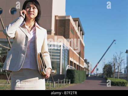 Business woman on cell-phone - Stock Photo