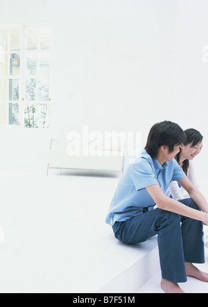 A couple talking in room - Stock Photo
