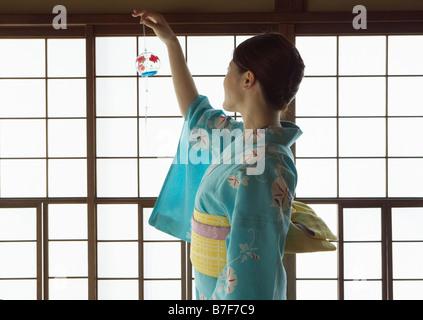 Yukata dressed woman and wind-chime - Stock Photo