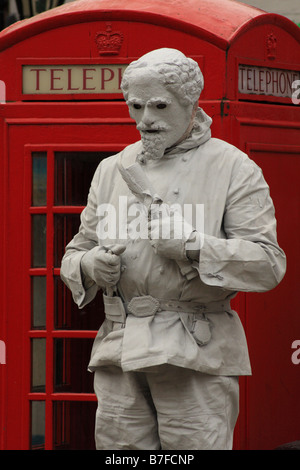 Street entertainer dressed as the famous dramatist, William Shakespeare performs in Stratford-upon-Avon, Warwickshire - Stock Photo