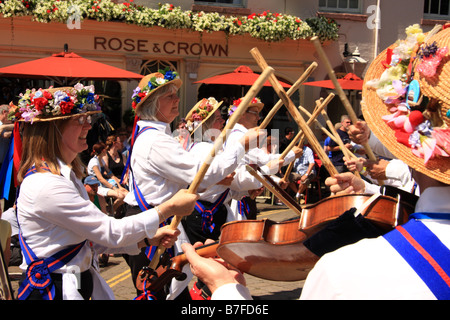 Morris dancers perform with sticks outside the Rose & Crown Pubic House at Warwick Folk Festival, Warwick, UK - Stock Photo