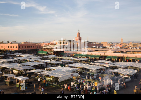 Marrakech Morocco. High view of food stalls and people in Place Djemma el Fna square in early evening in the Medina - Stock Photo