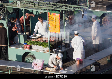 Marrakech Morocco North Africa Cooked food stall cooking in Place Djemma el Fna square in the evening in the Medina - Stock Photo