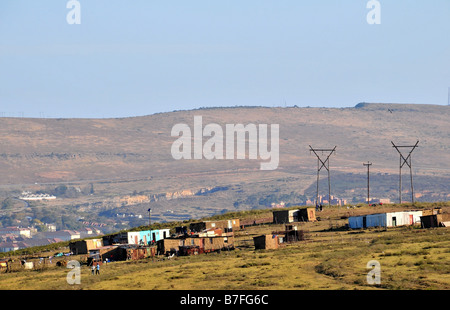 A small settlement of informal housing on open land around Grahamstown, South Africa - Stock Photo