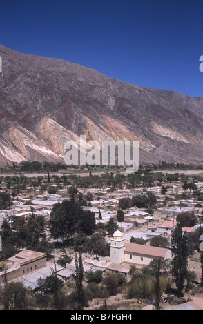 View over Maimara village and Rio Grande valley to 'The Painters Palette' / 'La Paleta del Pintor' rock formation, - Stock Photo