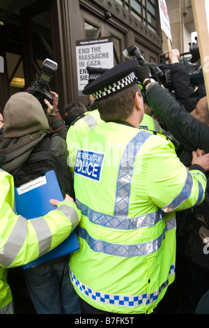 Police block the entrance to BBC in London after signed petition was delivered by delegation including Tony Benn - Stock Photo