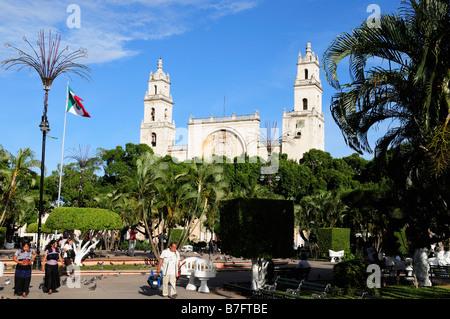 Main square in Merida, spires of Catedral de San Ildefonso - Stock Photo