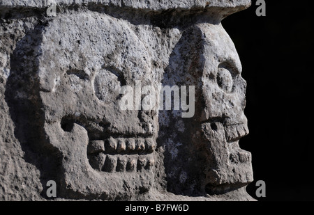 Carvings of stone skulls, Chichen Itza, Mexico - Stock Photo