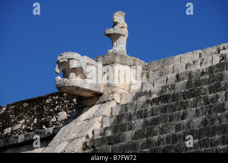 Chichen Itza, stone figure with serpents head on Temple of the Warriors - Stock Photo