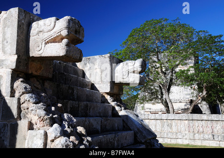 Chichen Itza, feathered serpent, Plaform of the Tigers and Eagles with Temple of the Jaguars in background - Stock Photo
