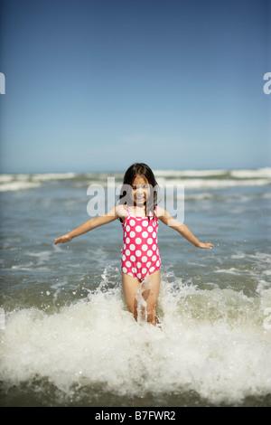 Five year old girl plays at the beach, Himatangi, New Zealand - Stock Photo