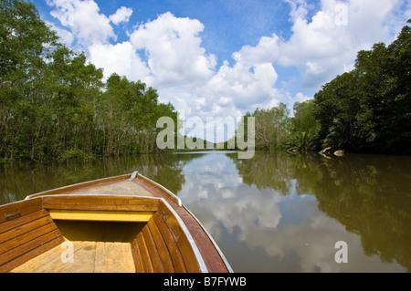 Boat on tour of Brunei river and Kampung Ayer water village in Bandar Seri Begawan, Brunei - Stock Photo