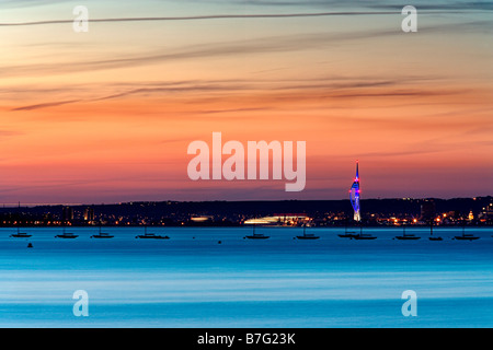 Dramatic sunset over The Solent and Spinnaker Tower - Stock Photo