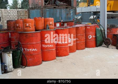 Stack red oil drums new TransEast yard December 2008 Mombasa Kenya - Stock Photo