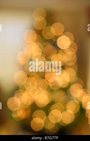 Defocused Christmas tree with lights - Stock Photo