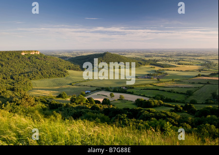 Beautiful scenic long-distance high view from Sutton Bank to Roulston Scar, Hood Hill & green flat farmland landscape - Stock Photo