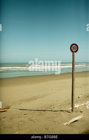 30kph Speed Limit signpost Himatangi beach New Zealand - Stock Photo