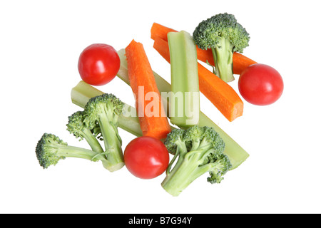 Broccoli tomatoes celery and carrot sticks cut out on white background - Stock Photo