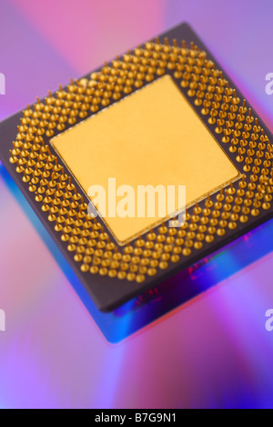 Computer cpu processor chip on purple dvd background - Stock Photo