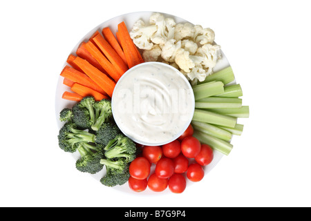 Vegetable platter with cauliflower celery tomatoes broccoli carrot sticks and ranch dip - Stock Photo