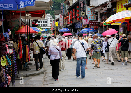 Tourists walking in the popular and crowded West street of  Yangshuo, Guangxi region, China