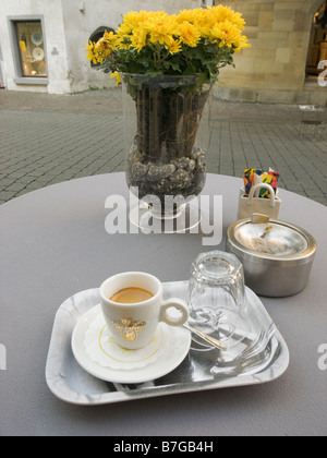 Espresso and a glass of water at an outdoors cafe ,Milan,Italy - Stock Photo