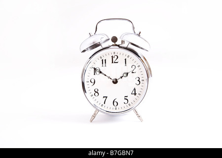 Tradditional alarm clock in silver - Stock Photo