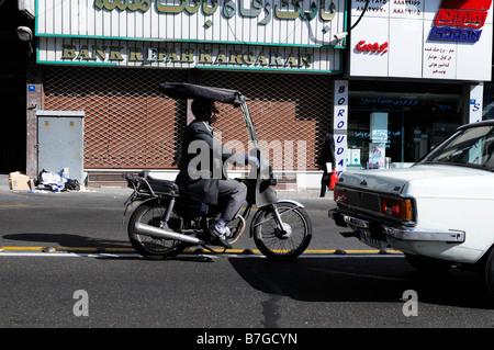 Man on a motorbike sitting in traffic tehran iran - Stock Photo