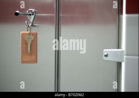 Mens Restroom Key Hanging on Coat Hook - Stock Photo