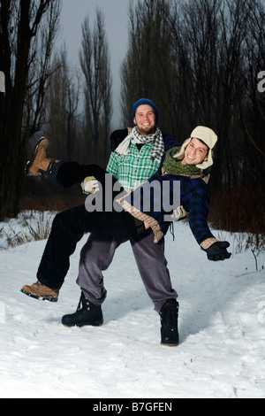 Two young men in forest having fun - Stock Photo